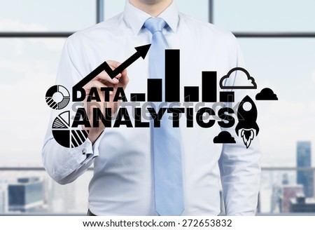 Businessman is drawing analytics solution on the glass screen. New York panoramic office view. - stock photo