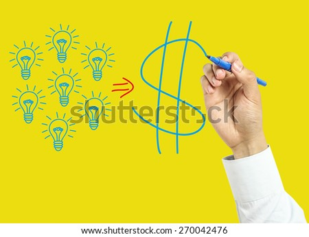 Businessman is drawing business success concept with marker on transparent board with yellow background. - stock photo