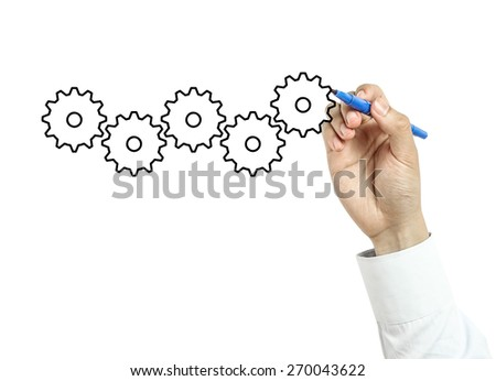 Businessman is drawing gears concept with blue marker on transparent board isolated on white background. - stock photo