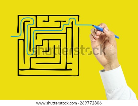 Businessman is drawing solution concept with marker on transparent board with yellow background. - stock photo