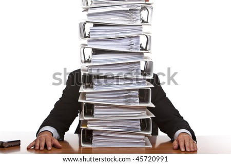 Businessman is frustrated, because of the huge documents he has to do. Isolated on white.