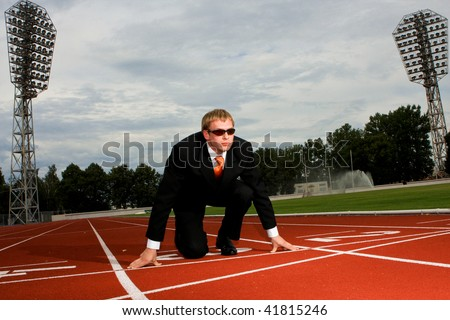 Businessman is getting ready for a run