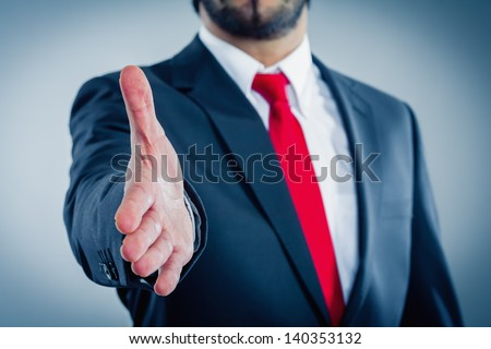 businessman is giving hand for handshake - stock photo