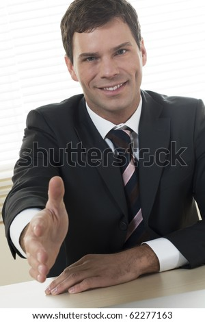 Businessman is going to shake someone's hand - stock photo