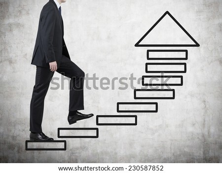Businessman is going upstairs. A concept of personal achievements.  - stock photo