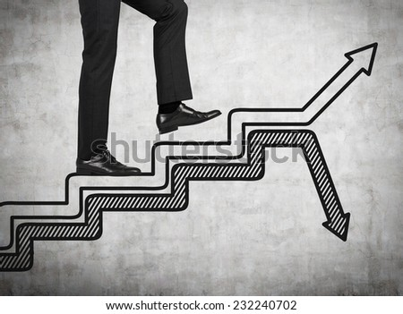 Businessman is going upstairs. A concept of personal achievements. , - stock photo