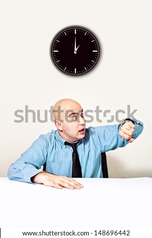 Businessman is late for a meeting.Checking time on wrist watch.