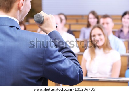 Businessman is making speech at conference room - stock photo