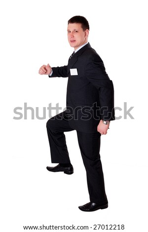 Businessman is making step on invisible stair