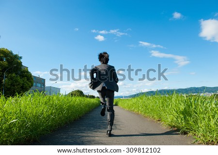 Businessman is moving forward, running - stock photo