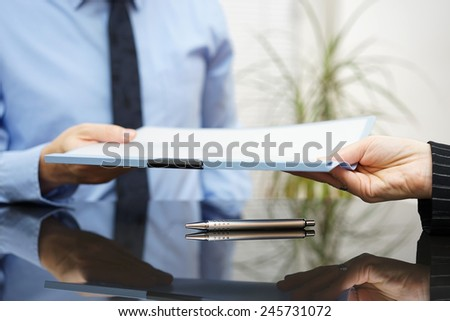 businessman is passing signed agreement to client after successful negotiation - stock photo