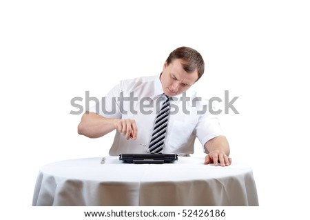 Businessman is picking at notebook, isolate white background. - stock photo