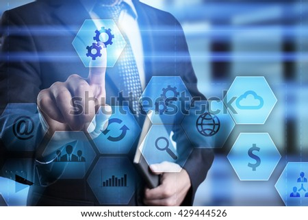 Businessman is pressing on the virtual screen and selecting gears icon.  - stock photo