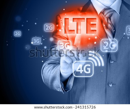 businessman is pushing his finger on lte button - stock photo