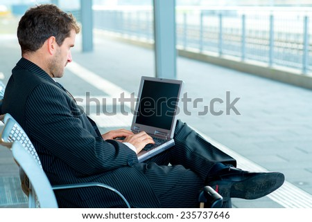 businessman is resting and using laptop  - stock photo
