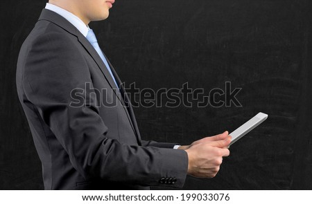 Businessman is searching information.