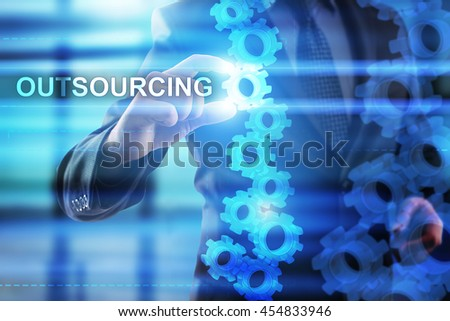 Businessman is selecting Outsourcing on the virtual screen.