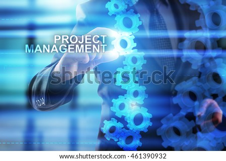 Businessman is selecting Project management on the virtual screen.
