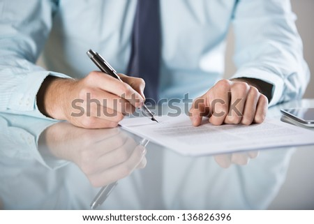 Businessman is signing a contract, business contract details