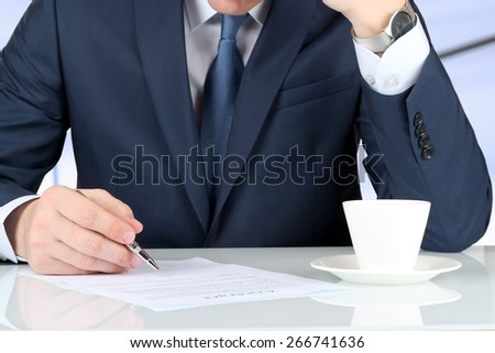 Businessman is signing a contract, business contract details - stock photo
