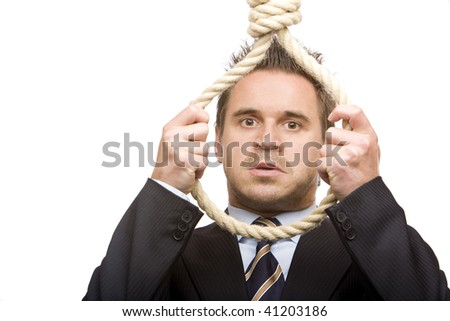 Businessman is standing in front of a gibbet and ready to make suicide. Isolated on white. - stock photo