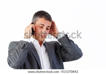 Businessman is stressing, while talking on the cell phone.