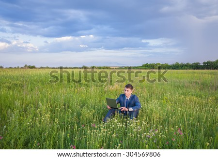 businessman is working and relaxing in the nature.