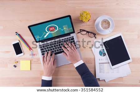 Businessman is working on desk -  SEO - stock photo