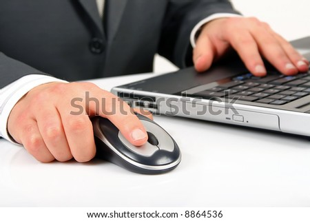 businessman is working or operating computer and mouse - stock photo