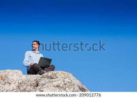 Businessman is working with laptop outdoor  - stock photo