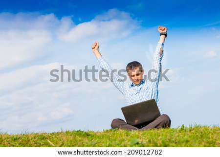 Businessman is working with laptop outdoor. Success concept - stock photo
