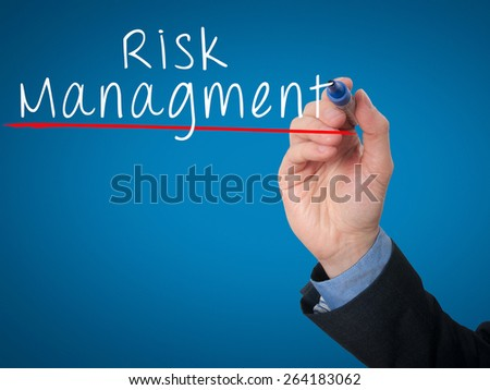 Businessman is writing Risk Management on the transparent board. Isolated on blue background. Stock Image - stock photo