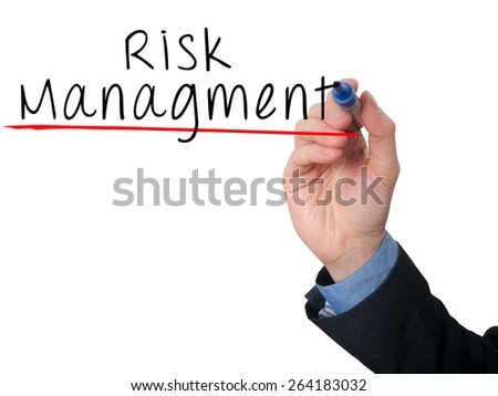 Businessman is writing Risk Management on the transparent board. Isolated on white background. Stock Image - stock photo