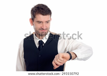 businessman islooking on his watch - stock photo