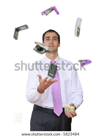 Businessman juggling his office tools. - stock photo