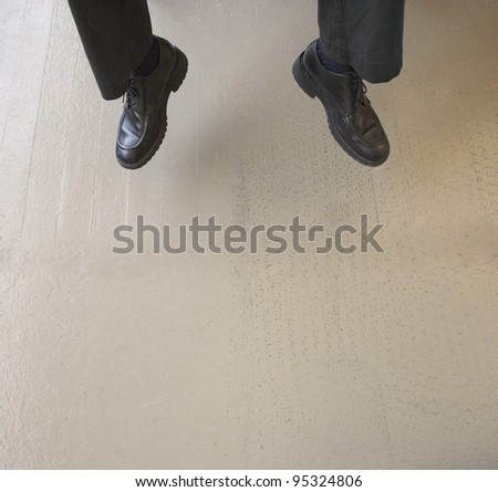 Businessman jumping for joy - stock photo