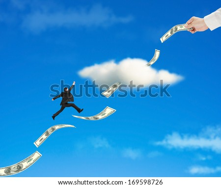 Businessman jumping on money trend through cloud with hand hold one in blue sky background