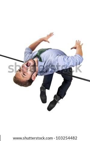 Businessman jumping over a high-jump bar - stock photo