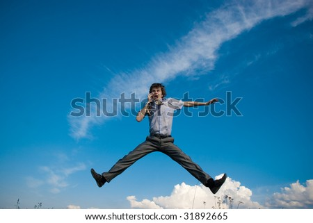 businessman jumping with mobile