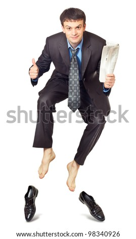 Businessman jumping with newspaper in hand on white - stock photo