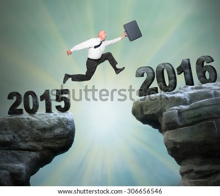 Businessman jumps to The New Year 2016. - stock photo