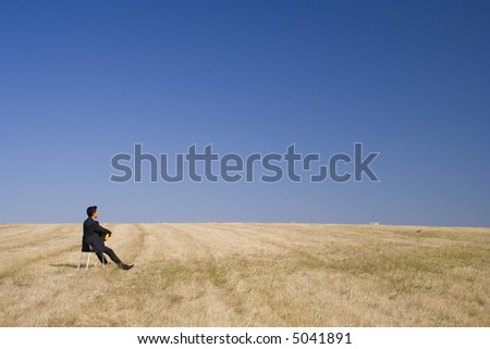 businessman just looking to the nature - stock photo