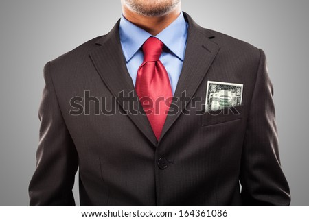 Businessman keeping a 500 Euro Banknote in his pocket - stock photo