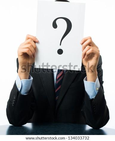 Businessman keeps a question mark - stock photo