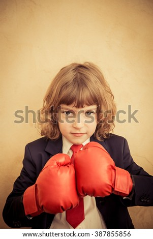 Businessman kid in red boxing gloves. Winner and success business concept