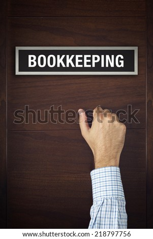Businessman knocking on Bookkeeping office door looking for a business service - stock photo
