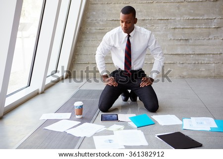 Businessman Laying Documents On Floor To Plan Project - stock photo