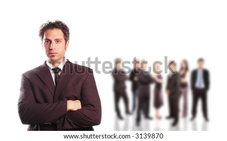businessman leader in front of his team - stock photo