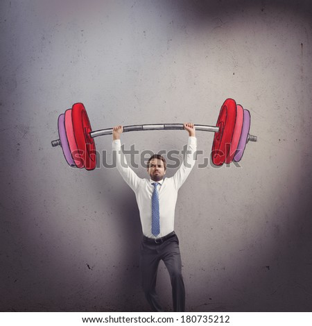 Businessman lifting barbell - stock photo