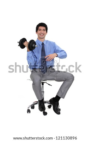 Businessman lifting weights - stock photo